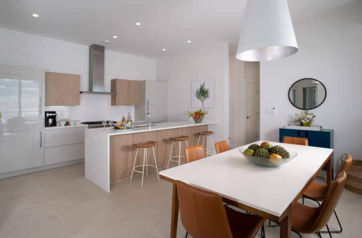 A white kitchen and dining area with wooden accents.