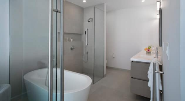 A bathroom with a tub, a shower booth, and a sink.