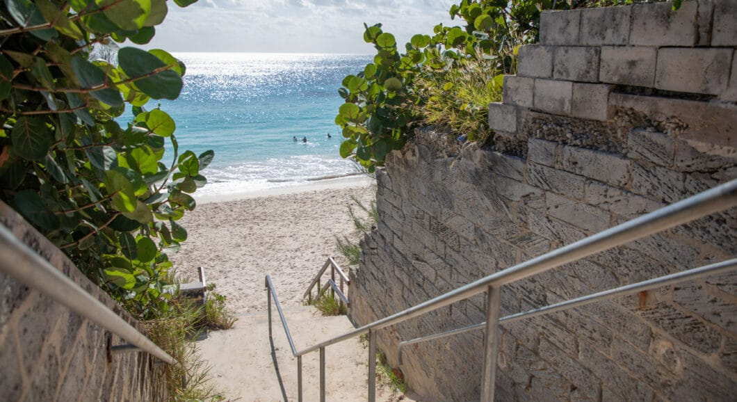 A small staircase leading to a beach.