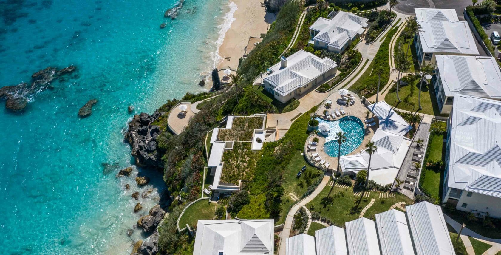 An aerial view of Azura Bermuda and the ocean.