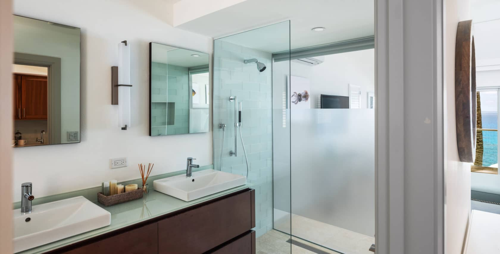 A bathroom with two sinks and a shower booth.