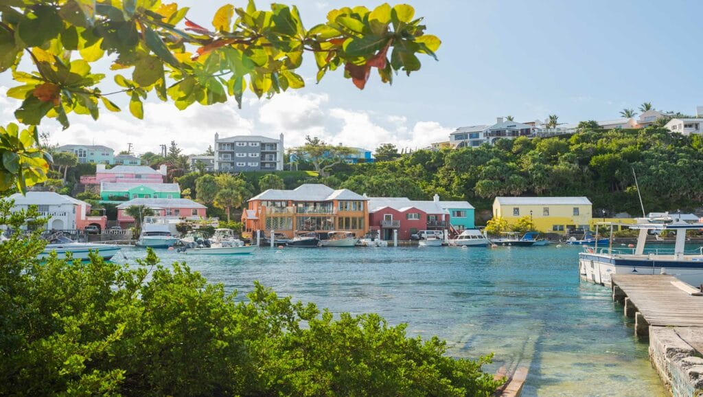 A waterfront with colorful buildings on the opposite shore.
